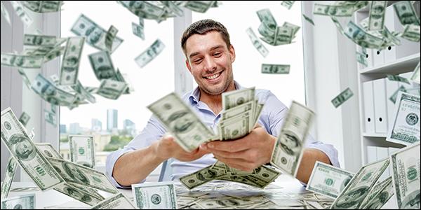 man making it rain with many $100 bills